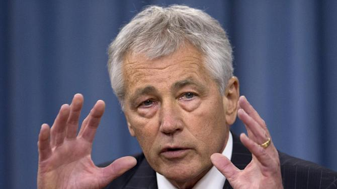 """Defense Secretary Chuck Hagel gestures as he speaks during a news conference at the Pentagon, Friday, May 17, 2013, to discuss sexual assaults in the military and the promotion of Lt. Gen. Curtis """"Mike"""" Scaparrotti to command U.S. troops in South Korea, among other topics. (AP Photo/Carolyn Kaster)"""
