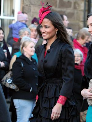 FILE - In this file photo dated Saturday, Feb. 26, 2011 Britain's Pippa Middleton, arrives at the wedding of the Duke and Duchess of Northumberland's eldest daughter Lady Katie Percy to city financier Patrick Valentine at St Michael's Church in Alnwick, England. Pippa Middleton went to Paris for a friend's birthday party and the British media are agog over an alleged gun flashed at paparazzi by one of her companions. Paris police say they've received no complaint and are not investigating, Tuesday, 17 April, 2012. (AP Photo/Scott Heppell, File)