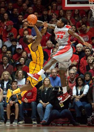 New Mexico outlasts Wyoming in overtime 66-61