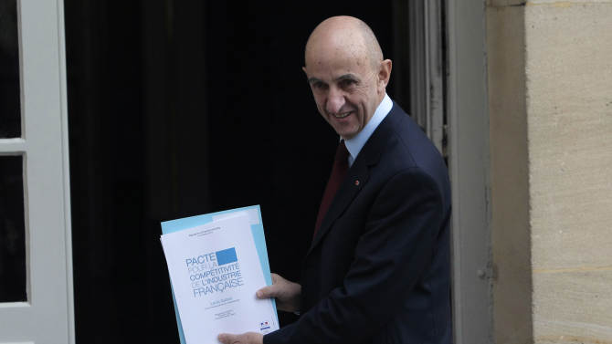 Former EADS chief Louis Gallois shows to the media the report prior to deliver it to French Prime Minister Jean Marc Ayrault at Matignon in Paris, Monday, Nov. 5, 2012. Gallois is presenting a report to the government on how to improve the competitiveness of French industry, which has fallen behind its neighbors and is struggling to compete in a globalized world. (AP Photo/Thibault Camus)