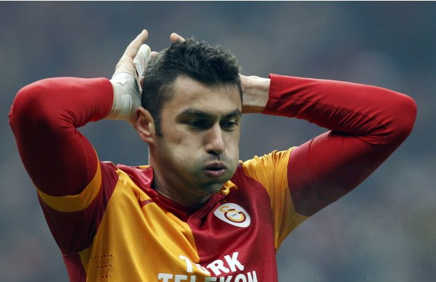 Galatasaray's Yilmaz reacts sh he missed to score against Schalke 04 during their Champions League soccer match in Istanbul