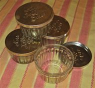 Vintage jelly jars with one-piece tin lids