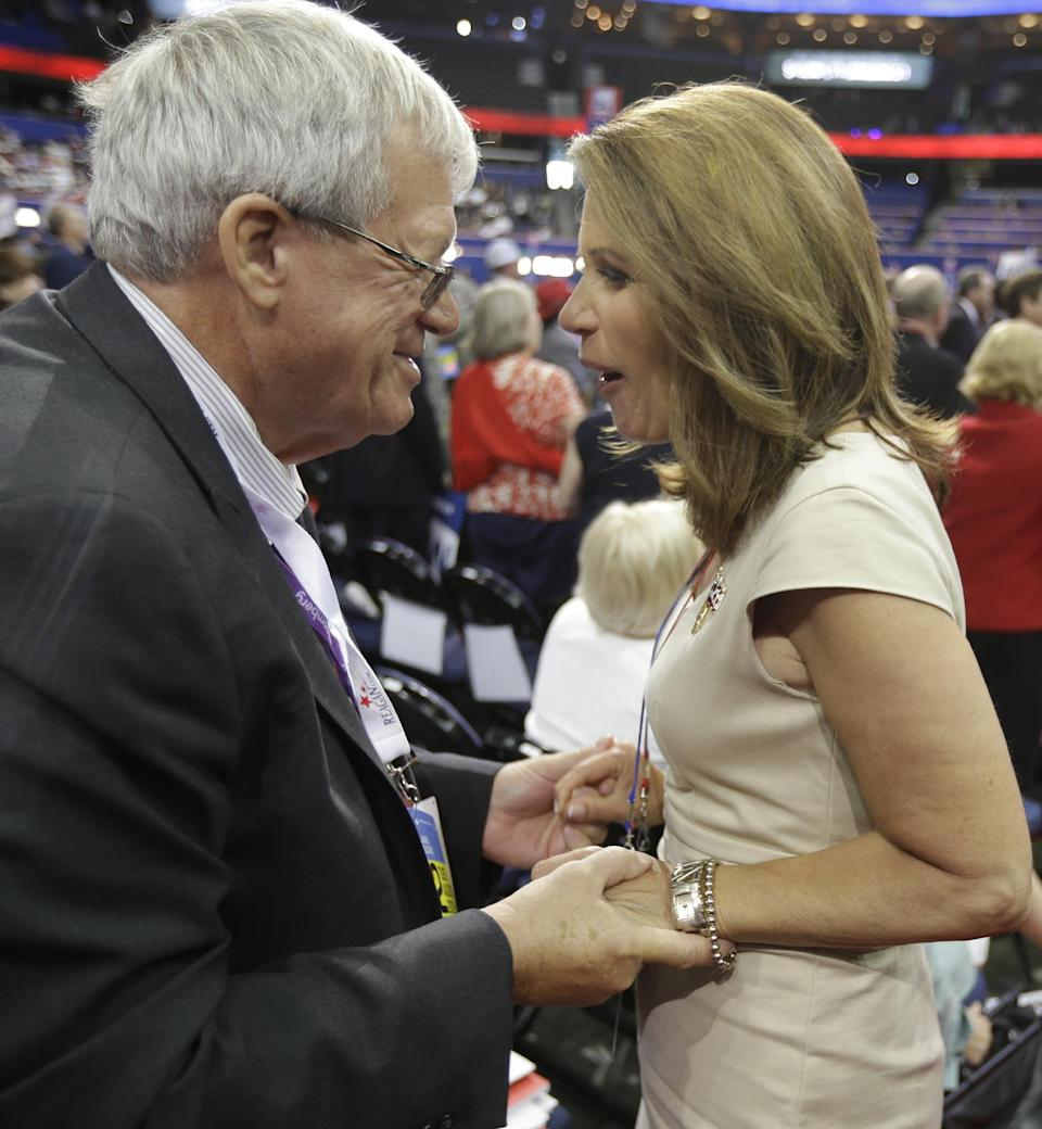 Former Speaker of the House Dennis Hastert, left, talks to U.S. Rep Michele Bachman, R-Minn., on the floor at the Republican National Convention in Tampa, Fla., on Tuesday, Aug. 28, 2012. (AP Photo/David Goldman)