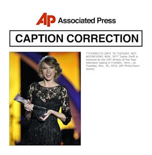 **CORRECTS DATE TO TUESDAY, NOT WEDNESDAY, NOV. 30** Taylor Swift is honored at the CMT Artists of the Year television taping in Franklin, Tenn., on Tuesday, Nov. 30, 2010. (AP Photo/Donn Jones)