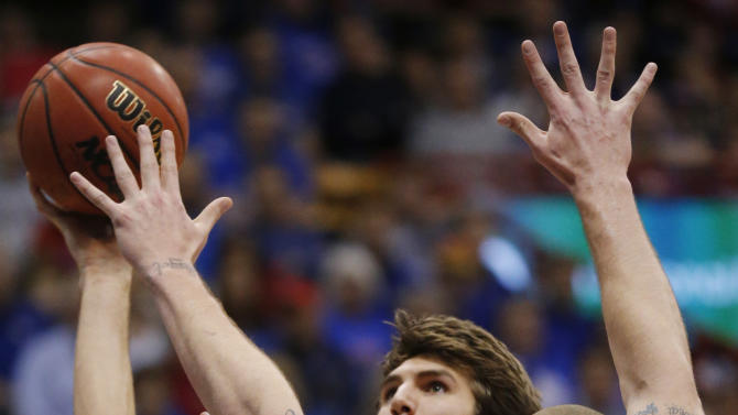 Kansas center Jeff Withey (5) is fouled by Oklahoma State center Philip Jurick (44) during the first half of an NCAA college basketball game in Lawrence, Kan., Saturday, Feb. 2, 2013. (AP Photo/Orlin Wagner)