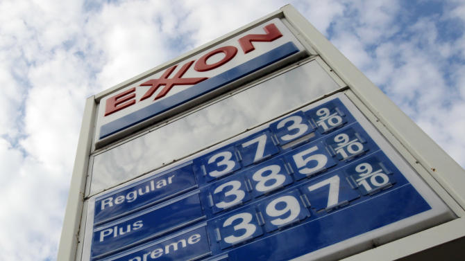 FILE - This Feb. 27, 2012 file photo shows gas prices at a Pittsburgh Exxon mini-mart. Exxon Mobil Corp. reports quarterly financial results before the market open on Thursday, Aug. 1, 2013. (AP Photo/Gene J. Puskar, File)