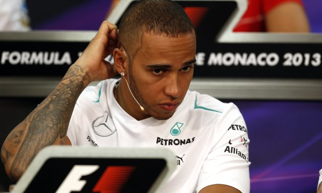 Mercedes Formula One driver Hamilton gestures during a news conference ahead of the Monaco F1 Grand Prix