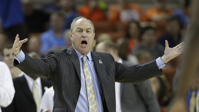 UCLA coach Ben Howland talks to his players during the second half of a second-round game of the NCAA college basketball tournament Friday, March 22, 2013, in Austin, Texas. Minnesota won 83-63. (AP Photo/Eric Gay)