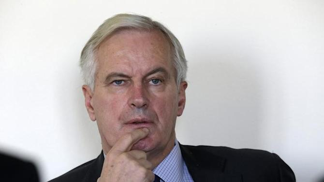 EU Commissioner Michel Barnier attends an interview with Reuters at his office in Paris