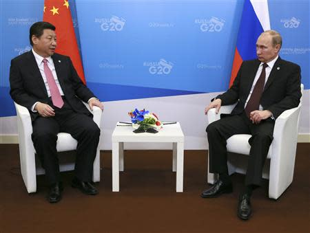 Russia's President Vladimir Putin meets his Chinese counterpart Xi Jinping at the G20 Summit in Strelna near St. Petersburg