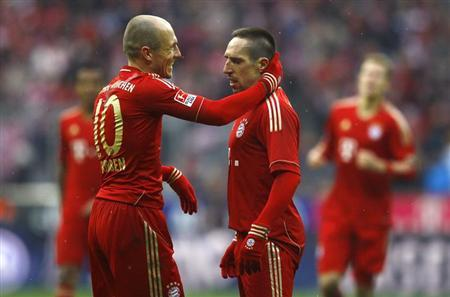 Franck Ribery of Bayern Munich celebrates his second goal against FC Schalke 04 with team mate Arjen Robben (L) during their German first division Bundesliga soccer match in Munich, February 26, 2012.