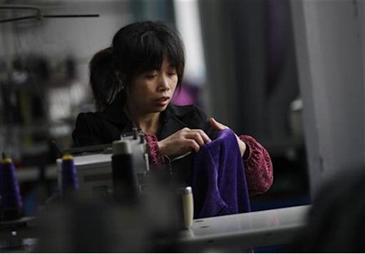 An employee works at the Yiwu Lianfa clothing factory in Yiwu, Zhejiang province