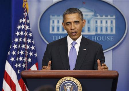 US President Barack Obama holds his year-end news conference in the press briefing room at the White House in Washington