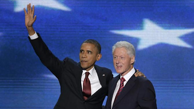 President Barack Obama joins Former President Bill Clinton on stage during the Democratic National Convention in Charlotte, N.C., on Wednesday, Sept. 5, 2012. (AP Photo/J. Scott Applewhite)