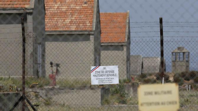 "A placard which reads ""Defence zone"" is seen at a military base in the southern French town of Miramas, near Marseille"
