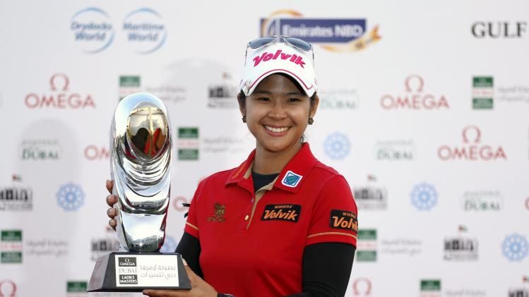 Phatlum of Thailand poses with the trophy after winning the Dubai Ladies Masters golf tournament in Dubai
