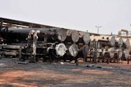 "Burnt facilities are seen at oil processing facility in Sudan's main petroleum centre of Heglig. Khartoum's warplanes bombed border regions, leading South Sudan's leader on Tuesday to accuse Sudan of declaring war, as the United States condemned the ""provocative"" strikes"