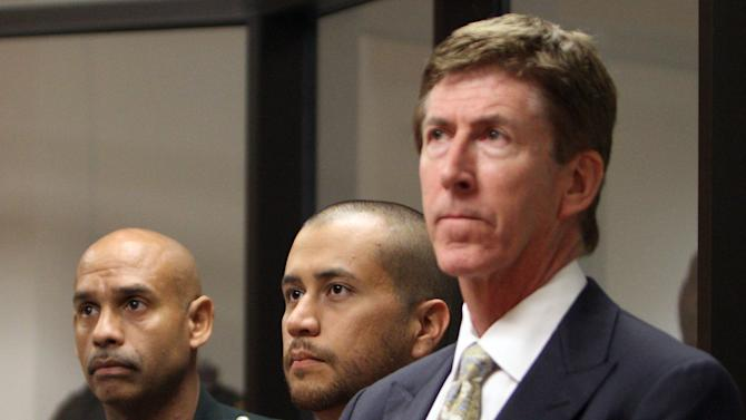FILE - George Zimmerman, center, stands with his attorney Mark O'Mara, right, and a Seminole County Deputy during a court hearing in this April 12, 2012 file photo taken in Sanford, Fla.  Attorneys for the former neighborhood watch volunteer charged with shooting Trayvon Martin to death on Wednesday Jan. 30, 2013 asked for more time to prepare his case, saying prosecutors had been slow to turn over evidence. (AP Photo/Gary W. Green, Orlando Sentinel, Pool, File)