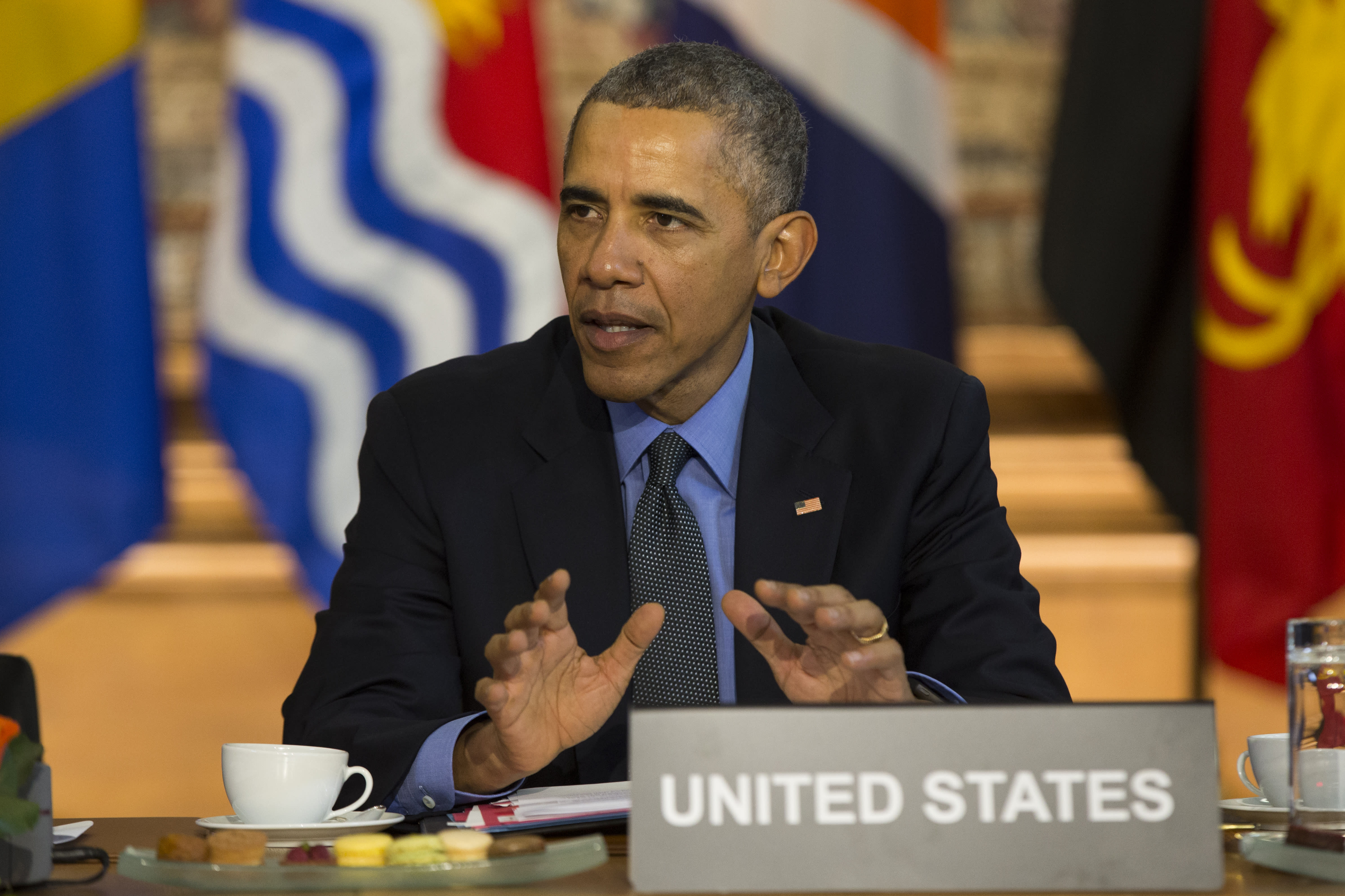 The Latest: Obama warns climate change will create refugees