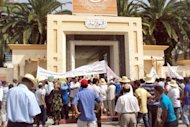<p>Local residents block the entrance to the Sidi Bouzid provincial government headquarters during a protest against the Islamist-led government. Police fired tear gas and rubber bullets to disperse a second anti-government protest in the central Tunisian town of Sidi Bouzid, birthplace of last year's revolution.</p>