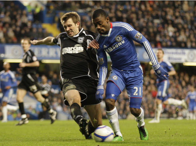 Chelsea's Salomon Kalou, right, competes with Ipswich Town's Gareth McAuley during their English FA Cup third round soccer match at Stamford Bridge, London, Sunday, Jan. 9, 2011. (AP Photo/Sang Tan) N