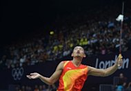 China's Lin Dan plays against South Korea's Lee Hyun Il in a men's semifinal singles badminton match at the London 2012 Olympic Games. Malaysian top-seed Lee Chong Wei will get the chance to avenge his 2008 Olympic badminton final loss to Lin after securing a gold medal showdown with the defending champion from China