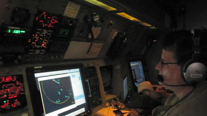In this Jan. 25, 2013 photo, a U.S. Customs and Border Protection detection officer analyzes radar signals inside a P3 Orion Airborne Early Warning Aircraft while flying over waters near the Pacific coast of Costa Rica.The Central American country abolished its army in 1948 and plowed money into education, social benefits and environmental preservation. As a result, Costa Rican officials say, the country can't battle ruthless and well-equipped Mexican drug cartels without U.S. help. The U.S. is patrolling Costa Rica's skies and waters and providing millions of dollars in training and equipment to Costa Rican officials who have launched a tough line on crime backed by top-to-bottom transformation of the law-enforcement and justice systems. (AP Photo/Mike Weissenstein)