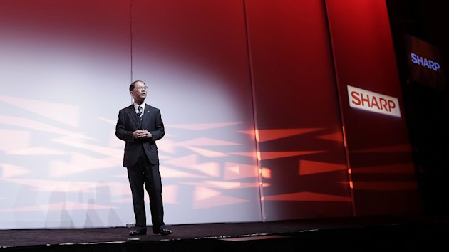 Sharp Electronics chairman and CEO Toshi Osawa announces the new line-up of televisions at the Consumer Electronics Show. (AP)