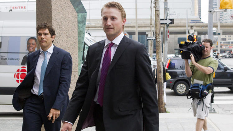 Tampa Bay Lightning's Steven Stamkos, center, and Colorado Avalanche's Steve Downie, left, arrive for collective bargaining talks  in Toronto on Tuesday, Aug. 14, 2012. Negotiations continue between the NHL and the NHLPA to avoid a potential lockout. (AP Photo/The Canadian Press, Chris Young)