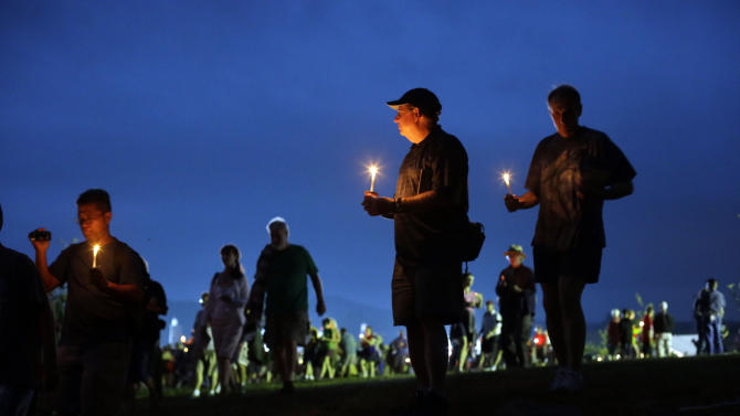 Members of the public take part in a candle light procession to Soldiers' National Cemetery during ongoing activities commemorating the 150th anniversary of the Battle of Gettysburg, Sunday, June 30, 2013, in Gettysburg, Pa. Union forces turned away a Confederate advance in the pivotal battle of the Civil War fought July 1-3, 1863, which was also the war's bloodiest conflict with more than 51,000 casualties. (AP Photo/Matt Rourke)