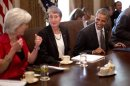 U.S. President Obama speaks with Health and Human Services Secretary Sebelius during a cabinet meeting at White House