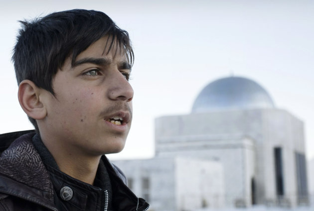 "In this Wednesday, Feb. 6, 2013 photo, Afghan actor Fawad Mohammadi, 14, speaks during an interview with The Associated Presson Nader Khan's hill, one of the areas where a part of the Afghani Oscar nominated short film titled ""Buzkashi Boys"" was shot in Kabul, Afghanistan. Fawad Mohammadi has spent half his life peddling maps and dictionaries to foreigners in the main tourist district in Kabul. Now the 14-year-old Afghan boy with beautiful green eyes is getting ready for his first airplane ride and a trip down the red carpet at the Oscars. (AP Photo/Musadeq Sadeq)"