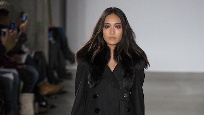 A model walks the runway at the presentation of the Altuzarra Fall 2013 fashion collection during Fashion Week, Saturday, Feb. 9, 2013, in New York. (AP Photo/Craig Ruttle)