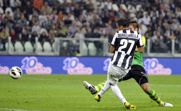 Juventus' Fabio Quagliarella shoots and scores against Chievo Verona during their Italian Serie A soccer match at Juventus stadium in Turin