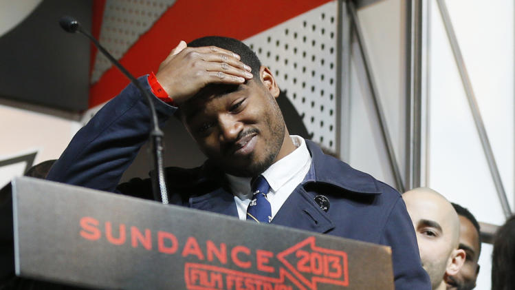 "Director and screenwriter Ryan Coogler reacts as he accepts the U.S. Grand Jury Prize: Dramatic for ""Fruitvale"" during the 2013 Sundance Film Festival Awards Ceremony on Saturday, Jan. 26, 2013 in Park City, Utah. (Photo by Danny Moloshok/Invision/AP)"