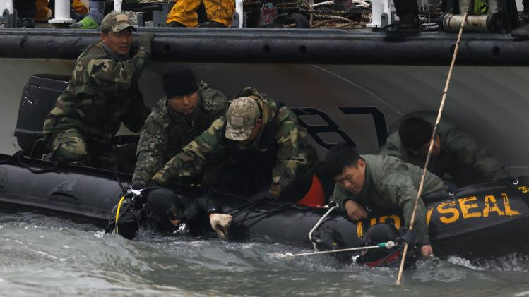 "Members from the South Korean Navy's UDT operate near where the capsized passenger ship ""Sewol"" sank, during the rescue operation in the sea off Jindo"