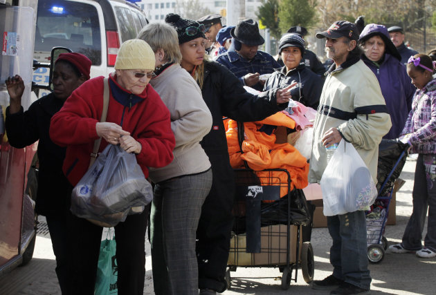 Residents line up for bundles of food at an American Red Cross station in the Coney Island section of Brooklyn, Monday, Nov. 5, 2012 in New York. The region is still cleaning up a week after Superstor