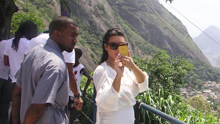 Pregnant Kim Kardashian Shows Off Her Kurves in Sheer Plunging Tops