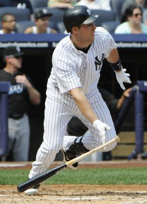 New York Yankees' Mark Teixeira hits an infield-single during the first inning of a baseball game against the Toronto Blue Jays, Sunday, Sept. 4, 2011, at Yankee Stadium in New York. The Yankees won 9-3.  (AP Photo/Bill Kostroun)