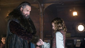 Jim Carter and Dakota Blue Richards in New Line Cinema's The Golden Compass