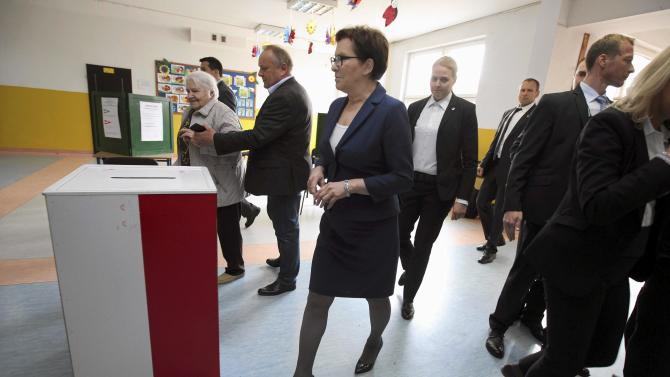 Polish Prime Minister Kopacz arrives at a polling station to vote during the second round of the presidential election in Radom