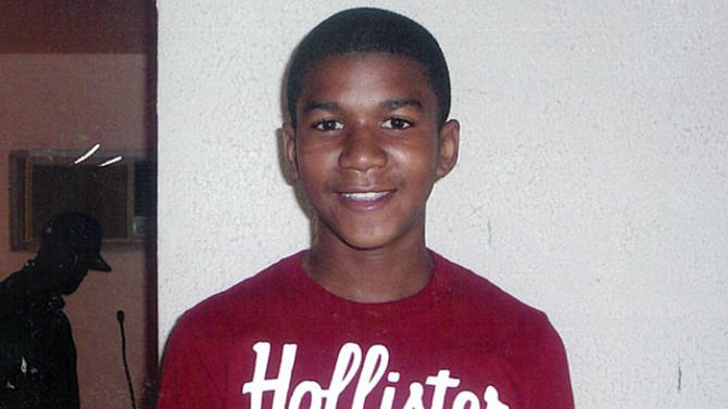 """FILE - This undated file family photo shows Trayvon Martin. Trayvon, 17, was slain in a 2012 shooting in Sanford, Fla., by neighborhood crime-watch captain George Zimmerman. The Goodman Theatre is the latest company to join a national initiative staging a night of short plays about the killing of Trayvon Martin. The Goodman will present six 10-minute works by Marcus Gardley, Tala Manassah, Mona Mansour, Winter Miller, Dominique Morisseau, Dan O'Brien, Quetzel Flores and A. Rey Pamatmat as part of a March 3 production of """"Facing Our Truth: Short Plays on Trayvon Martin, Race and Privilege."""" (AP Photo/Martin Family, File)"""