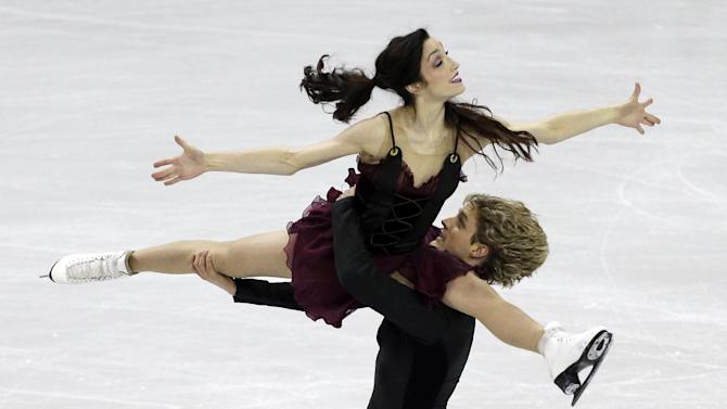 Meryl Davis, top, and Charlie White compete during the senior pairs free dance program at the U.S. figure skating championships on Saturday, Jan. 26, 2013, in Omaha, Neb. (AP Photo/Charlie Neibergall)