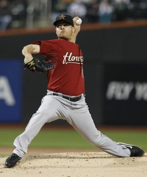 Houston Astros' Wandy Rodriguez delivers a pitch during the first inning of a baseball game against the New York Mets on Tuesday, April 19, 2011, in New York. (AP Photo/Frank Franklin II)