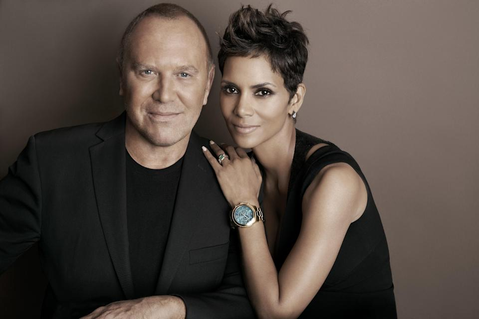 In this April 6, 2013 photo provided by Michael Kors, Kors and actress Halle Berry pose for a photo at Kors' Midtown office in New York. Kors and Berry have announced a partnership with the U.N. World Food Programme to raise money and awareness to tackle the issue of world hunger. (AP Photo)