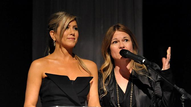 "EXCLUSIVE - Executive producers Jennifer Aniston, left, and Kristin Hahn, speak before Lifetime and Sony Pictures Television's premiere event  for ""Call Me Crazy: A Five Film"" at the Pacific Design Center on Tuesday, April 16, 2013 in West Hollywood, Calif. ""Call Me Crazy"" debuts on Saturday, April 20, 2013 at 8 PM on Lifetime. (Photo by John Shearer/Invision for Lifetime/AP Images)"