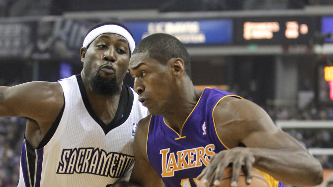 Los Angeles Lakers forward Meta World Peace, right, drives against Sacramento Kings forward John Salmons during the first quarter of an NBA basketball game in Sacramento, Calif., Wednesday, Nov. 21, 2012.(AP Photo/Rich Pedroncelli)