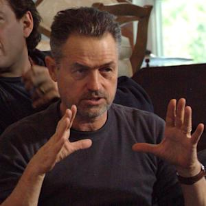 """This undated photo provided by Material Culture, Jonathan Demme is photographed on a movie set. Now 70 and having spent the better part of three decades amassing pieces from Haiti and other Caribbean countries as well as the United States, South America and Africa, the director of """"The Silence of the Lambs"""" said he's looking to """"streamline and simplify"""" his life by selling 90 percent of his well-regarded collection of self-taught or """"outsider"""" art. More than 900 pieces, many of them by artists with little or no formal training but abundant talent — will be auctioned at Philadelphia's Material Culture on March 29-30. The sale will be preceded by a weeklong exhibition that is free and open to the public. (AP Photo/Material Culture)"""
