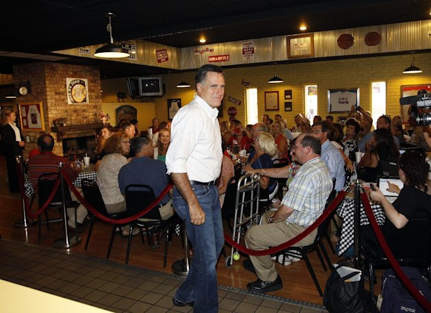 Republican presidential candidate and former Massachusetts Gov. Mitt Romney campaigns at Stepto&#39;s BBQ Shack in Evansville, Ind., Saturday, Aug. 4, 2012. (AP Photo/Charles Dharapak)