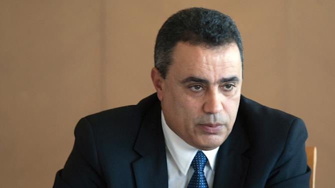 FILE - In this Nov. 7, 2013 photo, Mehdi Jomaa answers questions during a presser held in Tunis, Tunisia. Jomaa, an engineer and the former industry minister, has been selected to replace Larayedh and is expected to present his new cabinet later Thursday. (AP Photo, File)